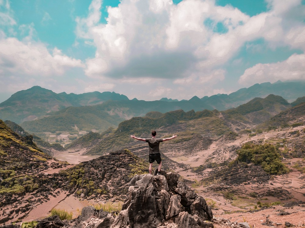 Photo devant la vallée de Ha Giang
